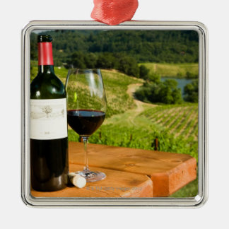 Bottle of red wine and glass on table christmas ornament