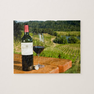 Bottle of red wine and glass on table jigsaw puzzle