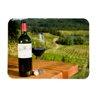 Bottle of red wine and glass on table rectangular photo magnet