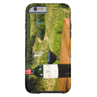 Bottle of red wine and glass on table tough iPhone 6 case