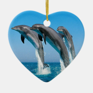bottlenose dolphins jumping out of clear blue sea christmas ornament