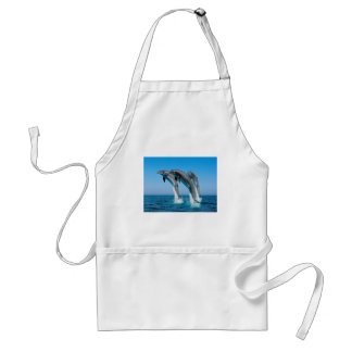 bottlenose dolphins jumping out of clear blue sea standard apron