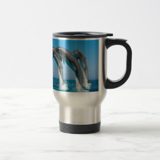bottlenose dolphins jumping out of clear blue sea travel mug