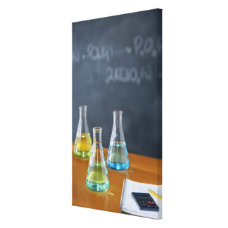 Bottles arranged for science experiment canvas print