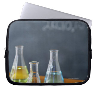 Bottles arranged for science experiment laptop sleeve