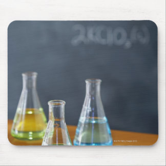 Bottles arranged for science experiment mousepad