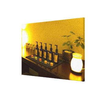 Bottles of aromatherapy oil in the beauty salon, canvas print