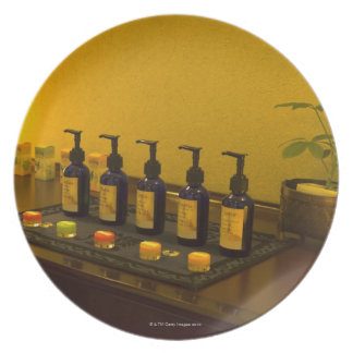 Bottles of aromatherapy oil in the beauty salon, plate