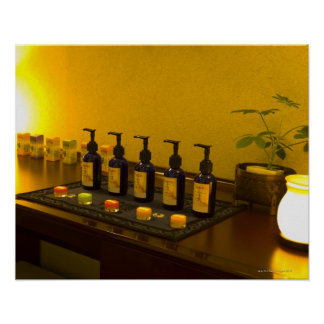 Bottles of aromatherapy oil in the beauty salon, poster