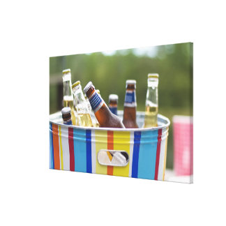 Bottles of beer in ice bucket canvas print