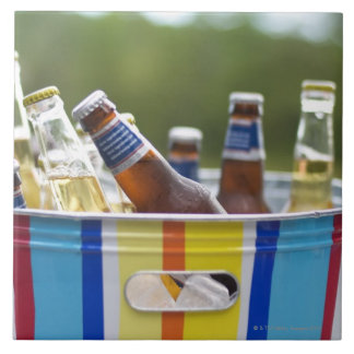 Bottles of beer in ice bucket large square tile