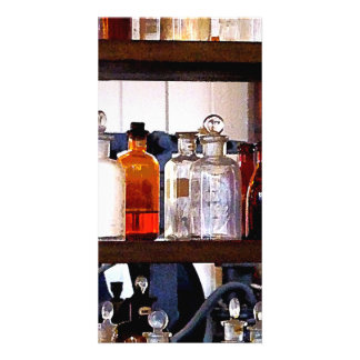 Bottles of Chemicals on Shelves Picture Card