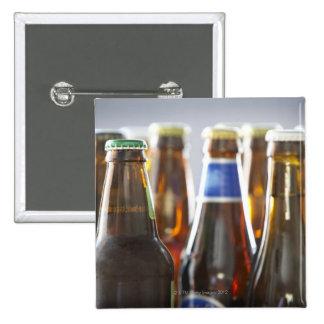 Bottles of various bottled beer in studio 15 cm square badge
