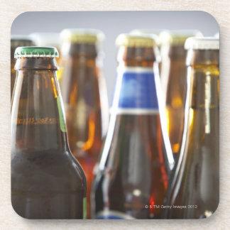 Bottles of various bottled beer in studio coaster