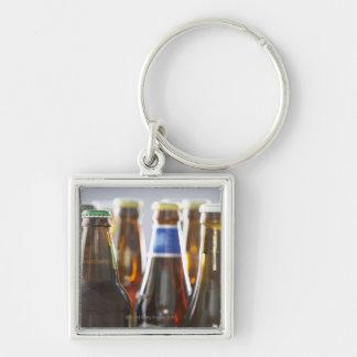 Bottles of various bottled beer in studio key ring