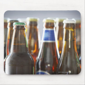 Bottles of various bottled beer in studio mouse mat