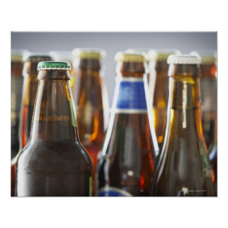 Bottles of various bottled beer in studio poster