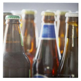 Bottles of various bottled beer in studio tile