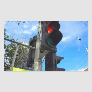 Bottom view on traffic light and road sign closeup rectangular sticker
