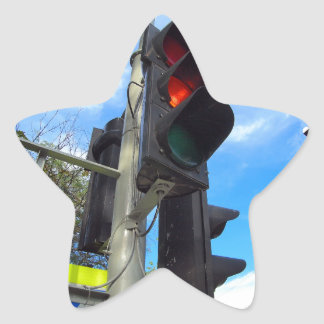 Bottom view on traffic light and road sign closeup star sticker