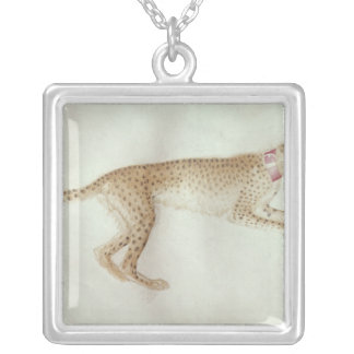 Bounding cheetah with a red collar silver plated necklace