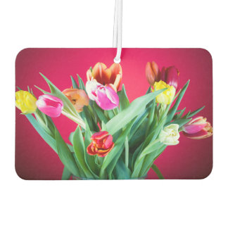Bouquet of tulips on red
