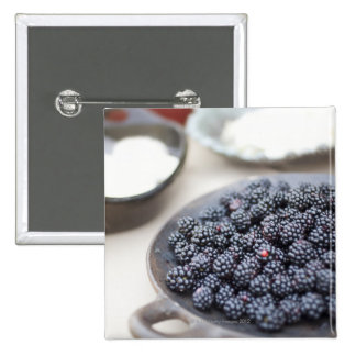 Bowl of blackberries on a table 15 cm square badge