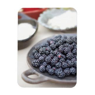 Bowl of blackberries on a table rectangular photo magnet