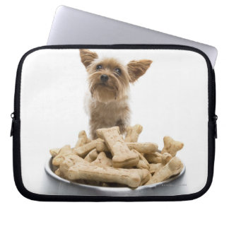 Bowl of dog treats by Yorkshire Terrier Laptop Computer Sleeves