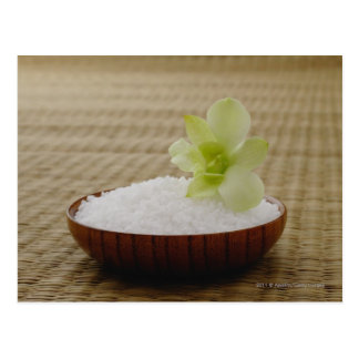 Bowl of rice with a flower on a tatami mat postcard