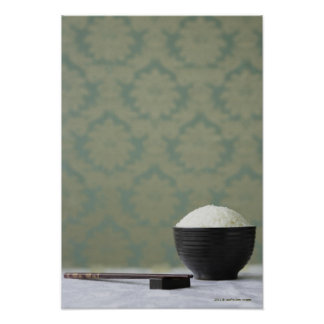Bowl of rice with chopsticks poster