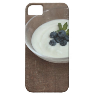 Bowl of yoghurt with blueberry on table iPhone 5 cases