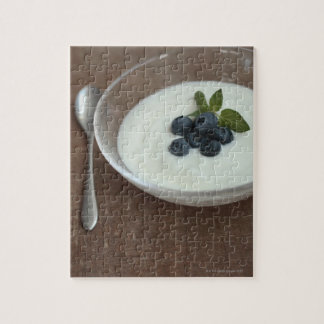 Bowl of yoghurt with blueberry on table jigsaw puzzle