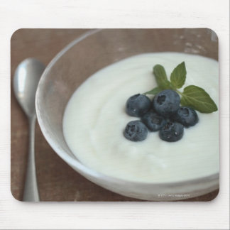 Bowl of yoghurt with blueberry on table mouse pad