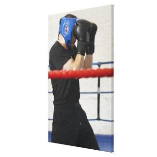 Boxer covering his face in ring canvas print