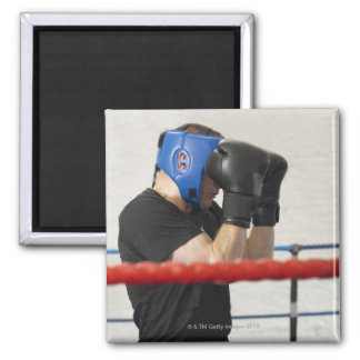 Boxer covering his face in ring square magnet