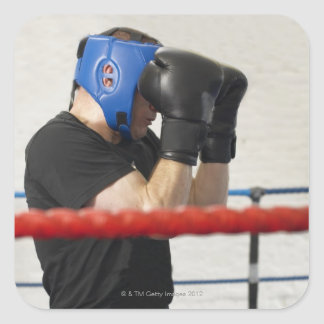 Boxer covering his face in ring square sticker