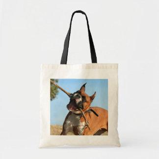 Boxer playing tote bag