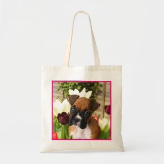 Boxer puppy in tulips tote bag