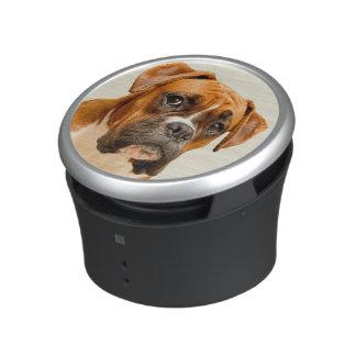Boxer puppy on ivory cream backdrop. bluetooth speaker
