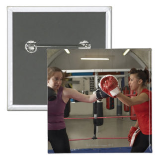 Boxer training with coach in gym 15 cm square badge