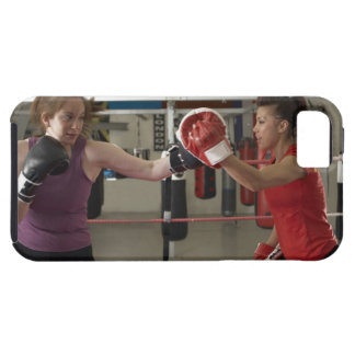 Boxer training with coach in gym iPhone 5 covers