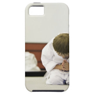 Boy (4-5 years) wearing karate outfit bowing, iPhone 5 case