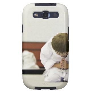 Boy (4-5 years) wearing karate outfit bowing, galaxy s3 case