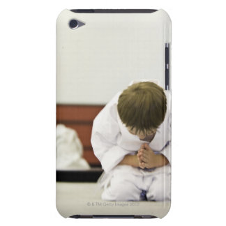 Boy (4-5 years) wearing karate outfit bowing, iPod Case-Mate case