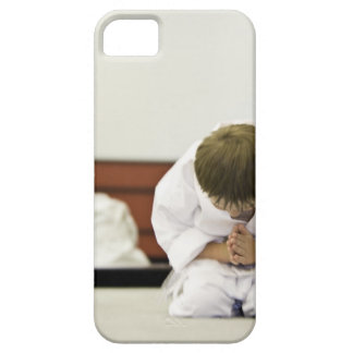 Boy (4-5 years) wearing karate outfit bowing, iPhone 5 covers