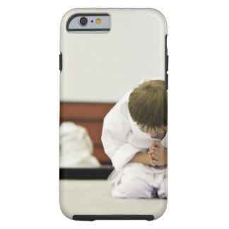 Boy (4-5 years) wearing karate outfit bowing, tough iPhone 6 case