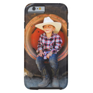 Boy (4-7) yrs old, sitting in tractor tire. tough iPhone 6 case