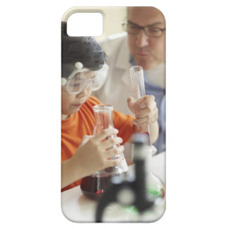 Boy (6-7) and teacher in chemistry class case for the iPhone 5