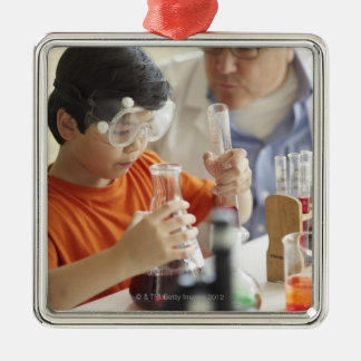 Boy (6-7) and teacher in chemistry class christmas ornament